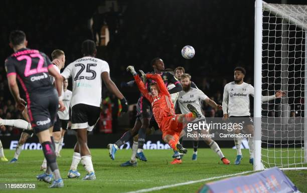 Leeds United's Edward Nketiah is denied by Fulham's Marek Rodak and Aleksandar Mitrovic during the Sky Bet Championship match between Fulham and...