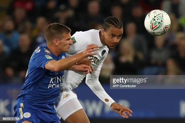 Leeds United's English defender Cameron BorthwickJackson vies with Leicester City's English midfielder Marc Albrighton during the English League Cup...