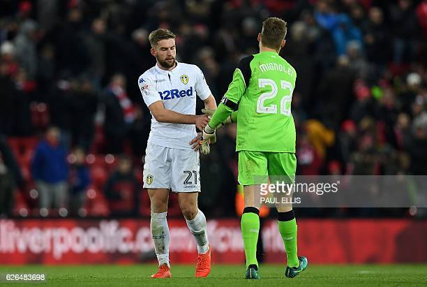 Leeds United's English defender Charlie Taylor congratulates Liverpool's Belgian goalkeeper Simon Mignolet following the EFL Cup quarterfinal...