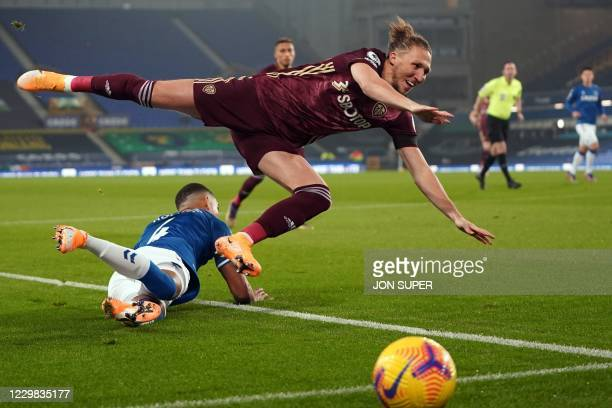Leeds United's English defender Luke Ayling is tackled by Everton's English defender Mason Holgate during the English Premier League football match...