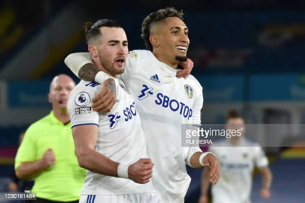 Leeds United's English midfielder Jack Harrison celebrates with Leeds United's Brazilian midfielder Raphinha after scoring their fifth goal during...