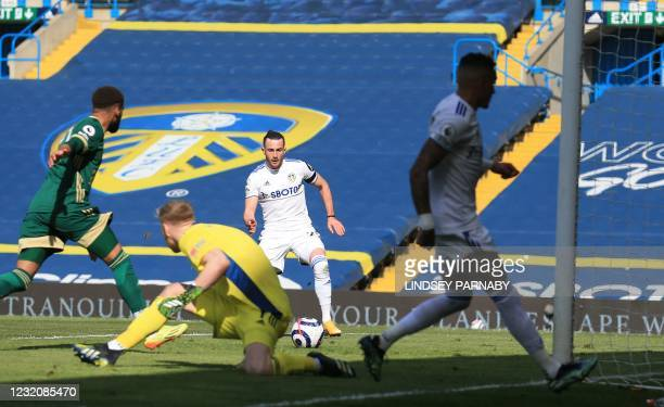 Leeds United's English midfielder Jack Harrison scores the opening goal during the English Premier League football match between Leeds United and...