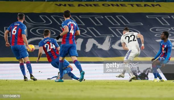 Leeds United's English midfielder Jack Harrison shoots past Crystal Palace's English defender Gary Cahill to scores the opening goal during the...