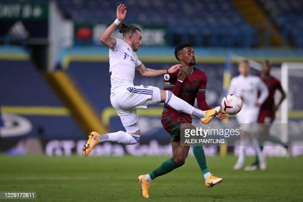 Leeds United's English midfielder Jack Harrison vies with Wolverhampton Wanderers' Portuguese defender Nelson Semedo during the English Premier...