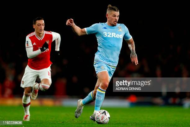 Leeds United's English midfielder Kalvin Phillips runs away from Arsenal's German midfielder Mesut Ozil during the English FA Cup third round...