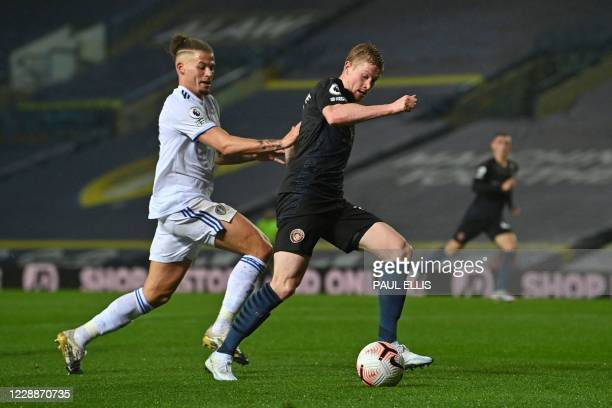 Leeds United's English midfielder Kalvin Phillips vies for the ball against Manchester City's Belgian midfielder Kevin De Bruyne during the English...