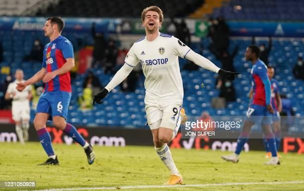 Leeds United's English striker Patrick Bamford celebrates scoring his team's second goal during the English Premier League football match between...