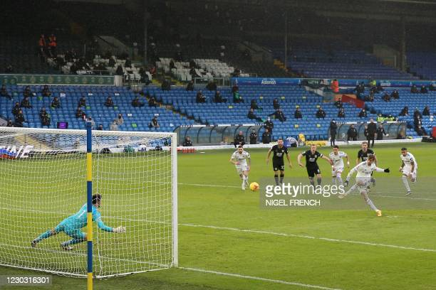 Leeds United's English striker Patrick Bamford scores the opening goal from the penalty spot during the English Premier League football match between...