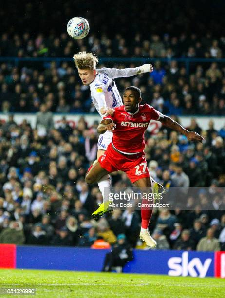 Leeds United's Ezgjan Alioski competes in the air with Nottingham Forest's Tendayi Darikwa at Elland Road on October 27 2018 in Leeds England