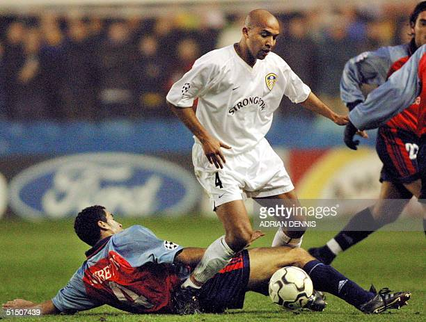 Leeds United's French player Olivier Dacourt is challenged by Deportivo La Coruna's Nourredine Naybet during the first leg of the quarterfinal...