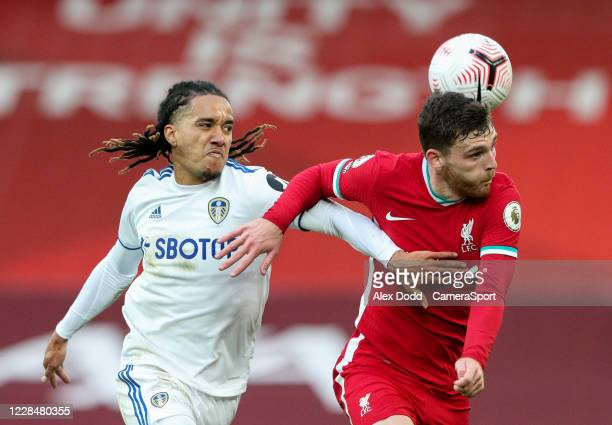 Leeds United's Helder Costa battles with Liverpool's Andrew Robertson during the Premier League match between Liverpool and Leeds United at Anfield...