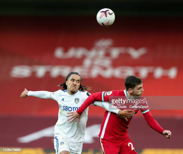 Leeds United's Helder Costa battles with Liverpool's Andy Robertson during the Premier League match between Liverpool and Leeds United at Anfield on...