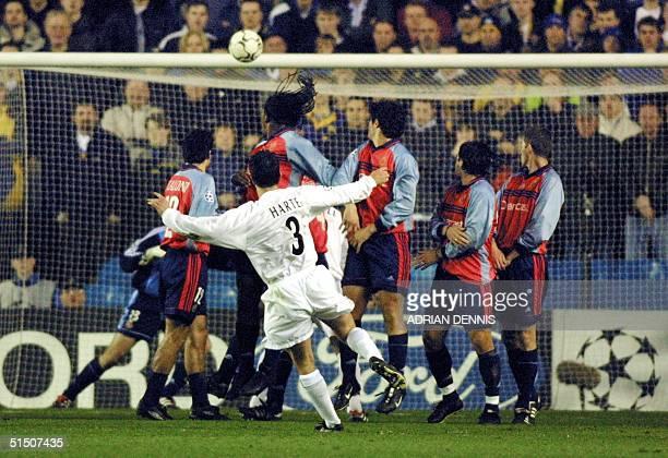 Leeds United's Ian Harte hits a free kick to score the opening goal while the Deportivo La Coruna's defensive wall turn their heads towards the goal...