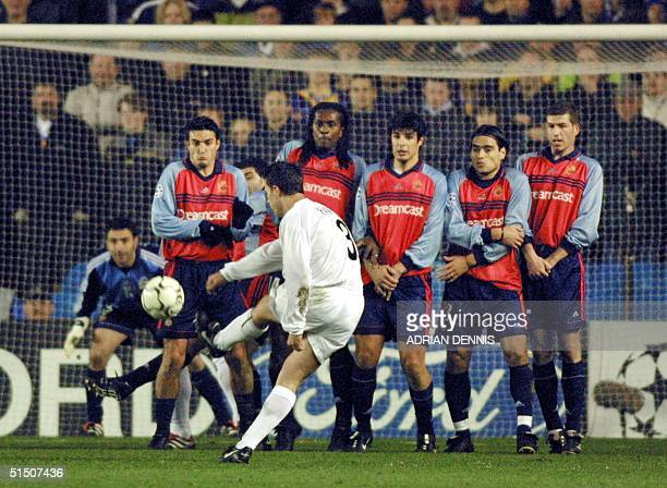Leeds United's Ian Harte hits a free kick to score the opening goal while the Deportivo La Coruna defensive wall look on during their Champions...