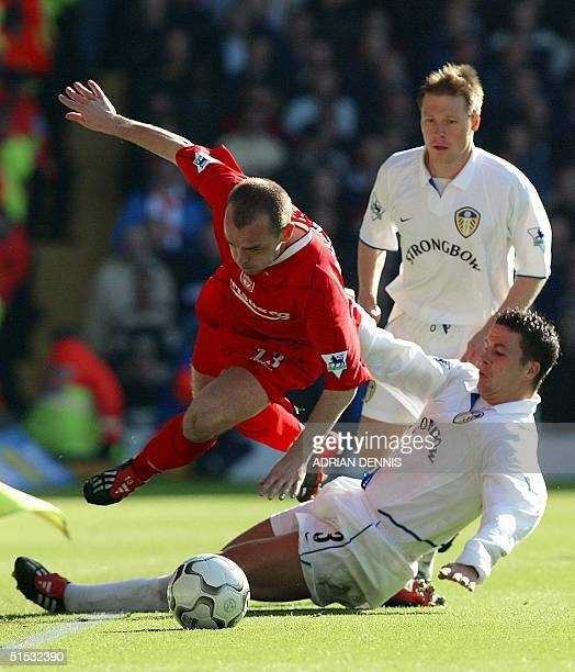 Leeds United's Ian Harte sends Liverpool's Danny Murphy flying with a tackle while Nick Barmby looks on during the Premier League match at Elland...