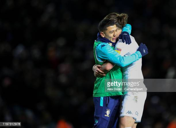 Leeds United's Ian Poveda hugs Luke Ayling after the game during the Sky Bet Championship match between Leeds United and Millwall at Elland Road on...