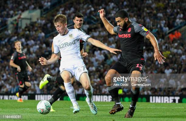 Leeds United's Jack Clarke holds off the challenge from Stoke City's Cameron CarterVickers during the Carabao Cup Second Round match between Leeds...