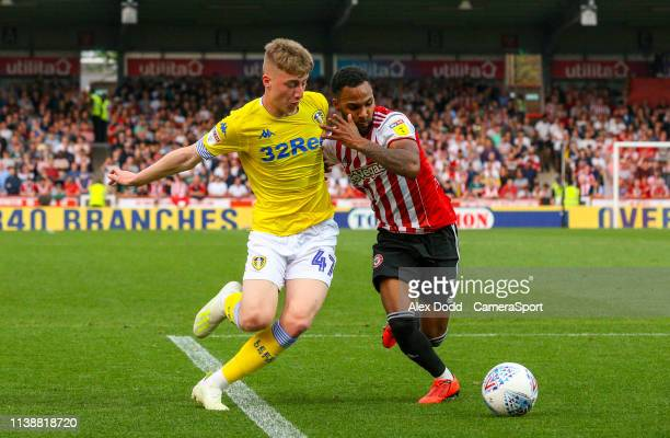 Leeds United's Jack Clarke vies for possession with Brentford's Rico Henry during the Sky Bet Championship match between Brentford and Leeds United...