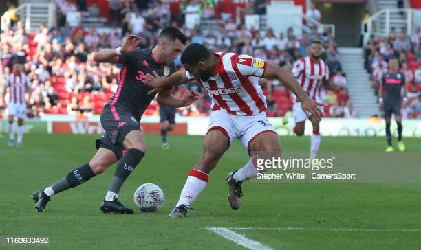 Leeds United's Jack Harrison battles with Stoke City's Cameron CarterVickers during the Sky Bet Championship match between Stoke City and Leeds...