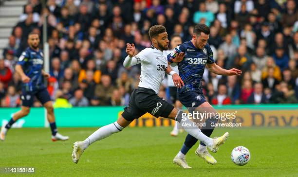 Leeds United's Jack Harrison vies for possession with Derby County's Jayden Bogle during the Sky Bet Championship Playoff First Leg match between...