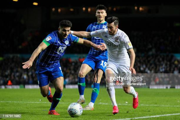 Leeds United's Jack Harrison vies for possession with Wigan Athletic's Sam Morsy during the Sky Bet Championship match between Leeds United and Wigan...