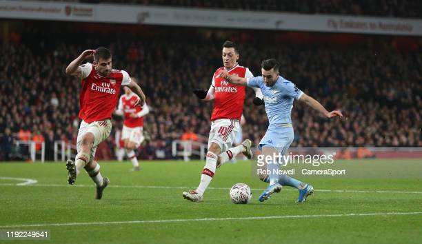 Leeds United's Jack Harrison with a shot under pressure from Arsenal's Sokratis Papastathopoulos and Mesut Ozil during the FA Cup Third Round match...
