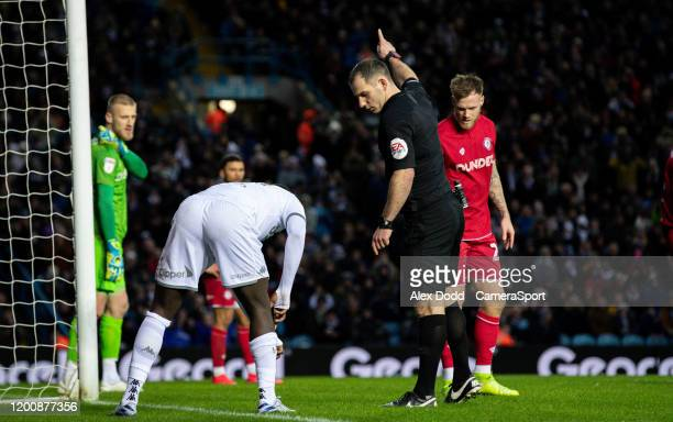 Leeds United's JeanKevin Augustin is told to put his shin pads back on by referee Tim Robinson during the Sky Bet Championship match between Leeds...