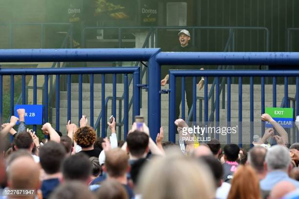 Leeds United's Kalvin Phillips comes out to celebrate with fans gathering outside their Elland Road ground to celebrate the club's return to the...