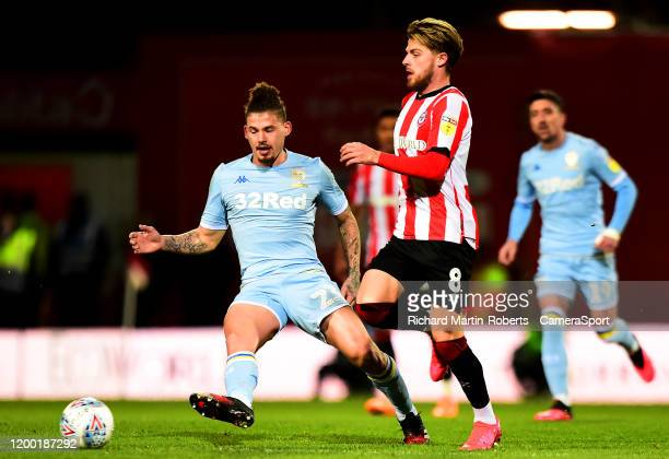 Leeds United's Kalvin Phillips competes with Brentford's Mathias Jensen during the Sky Bet Championship match between Brentford and Leeds United at...