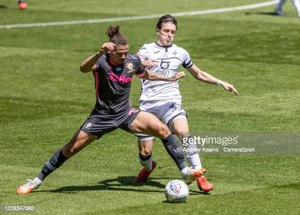Leeds United's Kalvin Phillips competing with Swansea City's Conor Gallagher during the Sky Bet Championship match between Swansea City and Leeds...