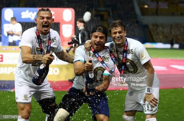 Leeds United's Kalvin Phillips , Gaetano Berardi and Ezgjan Alioski celebrate winning the Sky Bet Championship.