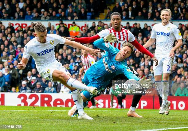Leeds United's Kalvin Phillips hits the post under pressure from Brentford's Luke Daniels during the Sky Bet Championship match between Leeds United...