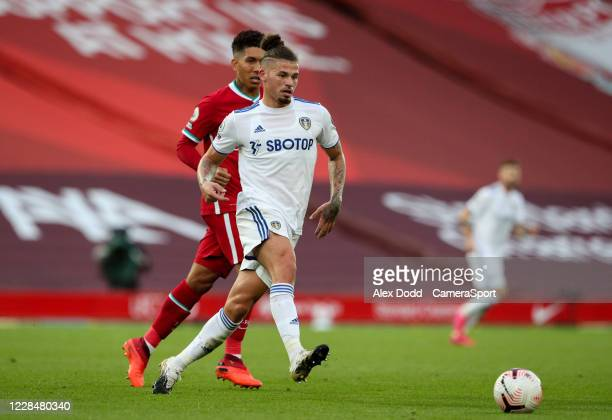 Leeds United's Kalvin Phillips moves the ball under pressure from Liverpool's Roberto Firmino during the Premier League match between Liverpool and...