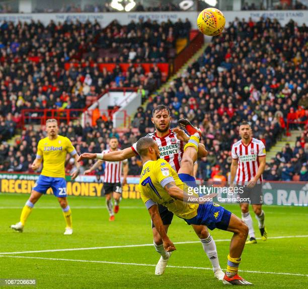 Leeds United's Kemar Roofe battles with Sheffield United's George Baldock during the Sky Bet Championship match between Sheffield United and Leeds...