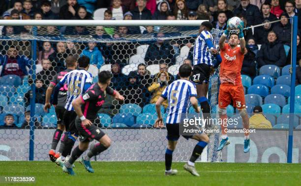Leeds United's Kiko Casilla competing in the air with Sheffield Wednesday's Dominic Iorfa during the Sky Bet Championship match between Sheffield...