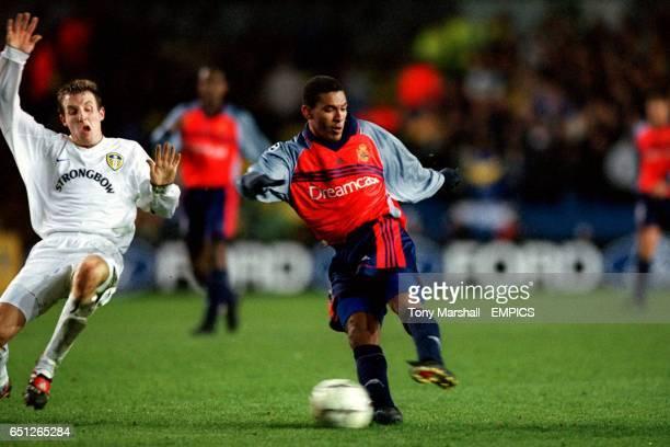 Leeds United's Lee Bowyer attempts to block a shot by Deportivo La Coruna's Djalminha