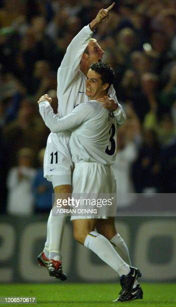 Leeds United's Lee Bowyer jumps on teammate Ian Harte to celebrate after Bowyer opened the scoring against Besiktas during the UEFA Champions League...