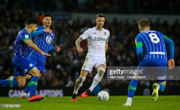 Leeds United's Liam Cooper takes on Wigan Athletic's Sam Morsy and Lee Evans during the Sky Bet Championship match between Leeds United and Wigan...