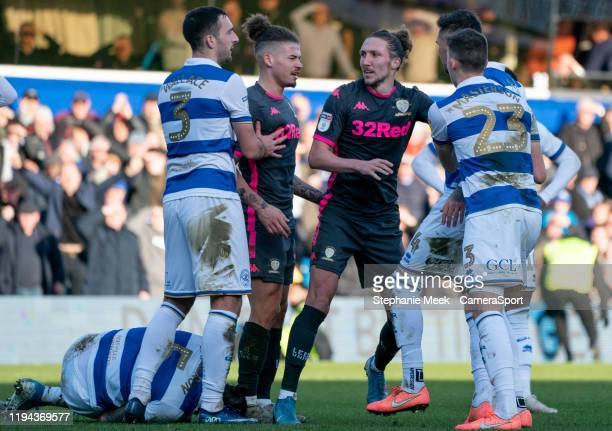Leeds United's Luke Ayling caught between Queens Park Rangers after a tackle on Geoff Cameron during the Sky Bet Championship match between Queens...