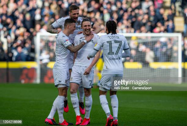 Leeds United's Luke Ayling celebrates scoring the opening goal with Ben White and Liam Cooper during the Sky Bet Championship match between Hull City...