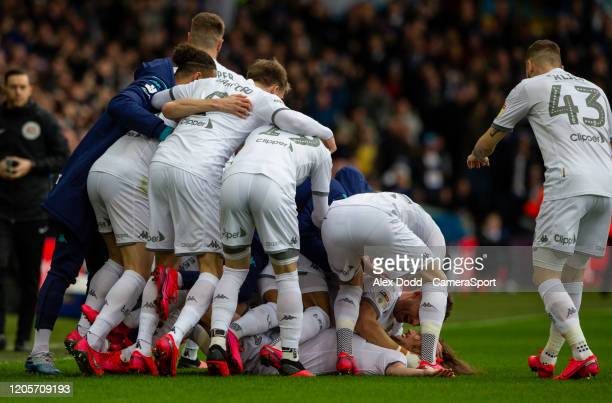 Leeds United's Luke Ayling celebrates scoring the opening goal with teammates during the Sky Bet Championship match between Leeds United and...