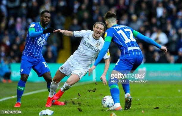 Leeds United's Luke Ayling goes down under the challenge of Wigan Athletic's Gavin Massey during the Sky Bet Championship match between Leeds United...