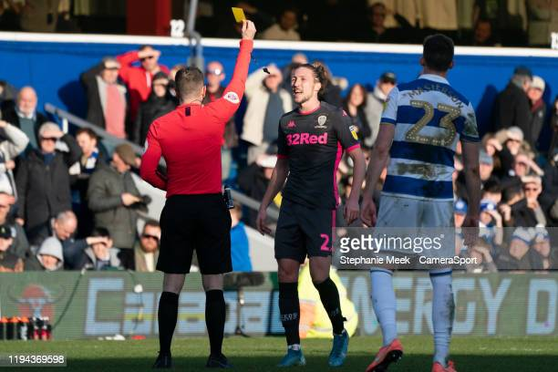 Leeds United's Luke Ayling is shown a yellow card by referee P Bankes during the Sky Bet Championship match between Queens Park Rangers and Leeds...