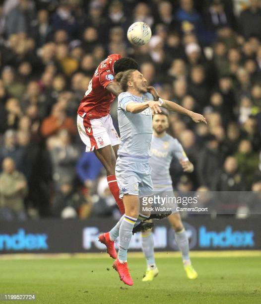 Leeds United's Luke Ayling jumps with Nottingham Forest's Sammy Ameobi during the Sky Bet Championship match between Nottingham Forest and Leeds...
