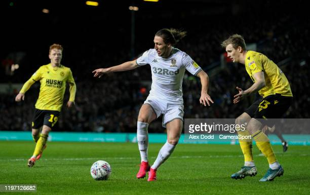 Leeds United's Luke Ayling shields the ball from Millwall's Jon Dadi Bodvarsson during the Sky Bet Championship match between Leeds United and...