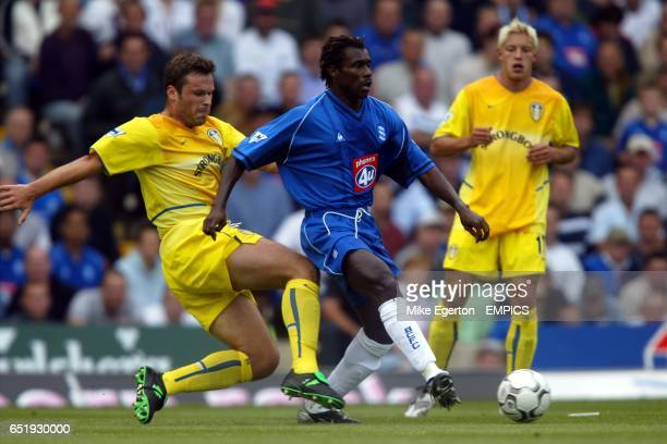 Leeds United's Mark Viduka tackles Birmingham's Aliou Cisse