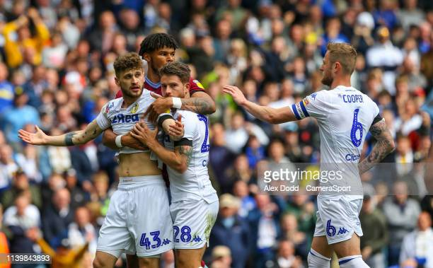 Leeds United's Mateusz Klich and Gaetano Berardi are held by Aston Villa's Tyrone Mings after Klich scored a controversial goal during the Sky Bet...