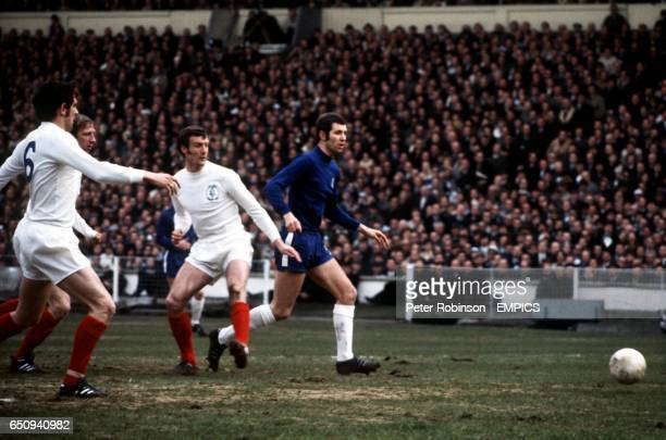 Leeds United's Norman Hunter Jack Charlton and Paul Madeley watch as Chelsea's Peter Osgood tries to break through