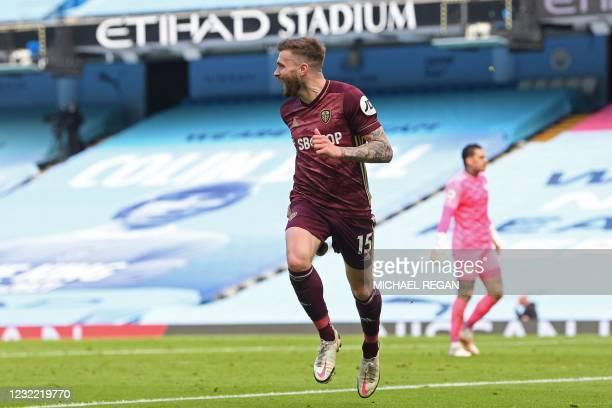 Leeds United's Northern Irish midfielder Stuart Dallas celebrates after scoring a goal during the English Premier League football match between...