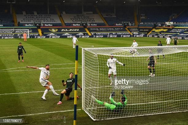 Leeds United's Northern Irish midfielder Stuart Dallas shoots to score the opening goal past Tottenham Hotspur's Spanish defender Sergio Reguilon and...